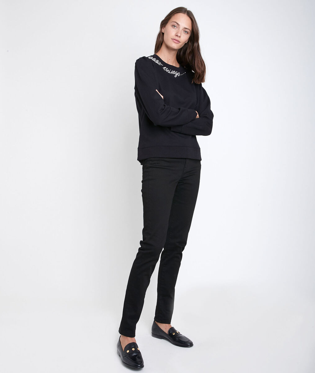 Suzy, the iconic black slim-fit jeans  PhotoZ | 1-2-3